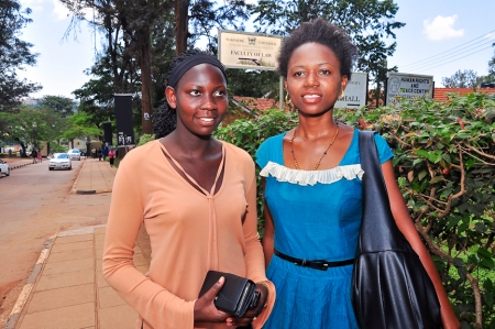 Joaninne and Monica in front of Makerere University